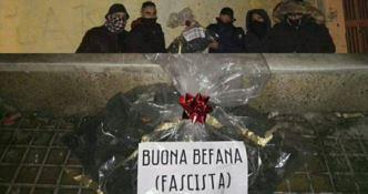 """Torna la """"Befana fascista"""" e consegna cenere e insulti al Pd di Crotone"""