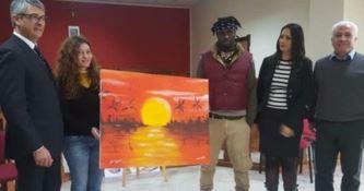 I due artisti e il quadro realizzato (FOTO ANSA)
