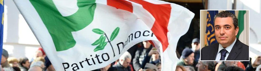 Una bandiera del Pd e Sebi Romeo