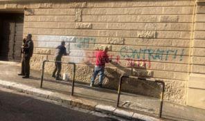 Scritte offensive sui muri della Prefettura