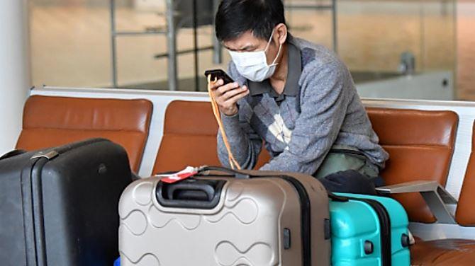 Turista asiatico (foto Ilsole24ore)