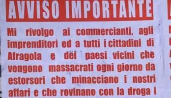 I manifesti affissi ad Afragola (foto Ansa)